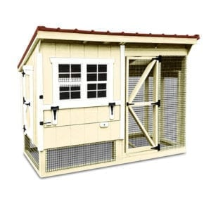 yellow chicken coop with attached chicken run and red metal roof made from wood